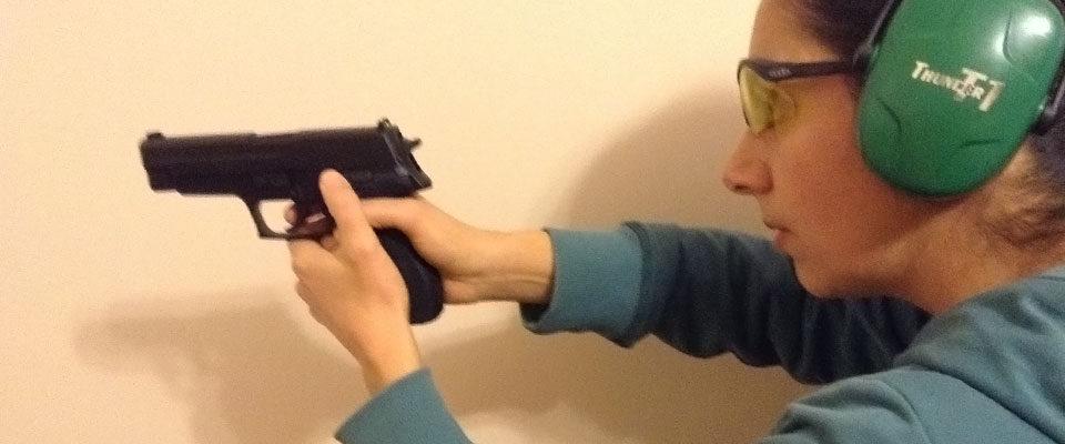 Nina with gun